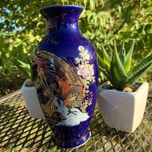 Beautiful ceramic blue painted bird vase